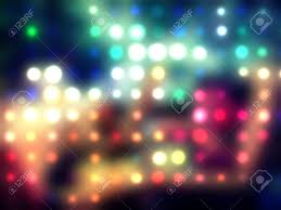 grungy dotted blurred background of colored lights stock photo