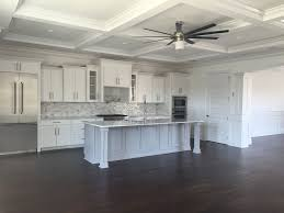 wainscoting kitchen island traditional kitchen with flat panel cabinets u0026 high ceiling