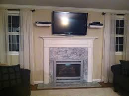 interior marble fireplace mantel design idea under tv wall mount