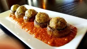 cuisine alligator our signature dish alligator stuffed mushrooms w alligator sauce
