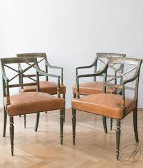 four antique dining room chairs painted and parcel gilded