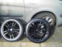 set 4 black 5 spoke twin bladed 4 stud 4 x 100 alloys c w v good