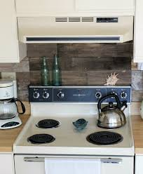 wood backsplash kitchen i the idea of the reclamed wood for a kitchen splashback its