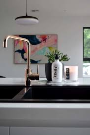 kitchen with copper faucet and black sink cleaning ways for