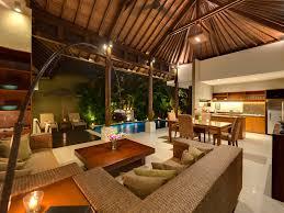 10 lakshmi villas solo living area view to pool at night jpg
