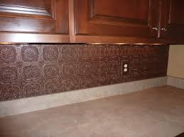 interior faux tin wallpaper painted with rubbed bronze spray