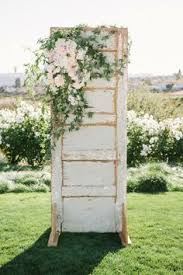 wedding arch using doors rustic ceremony decor ceremony spaces details