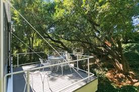 an amazing tree covered glass house for sale in the berkeley