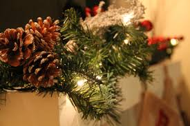 free stock photo of christmas garland with pine cones