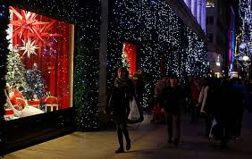 Christmas Decorations For Window Displays by Christmas Lights Lure Shoppers In Search Of Bargains Photos And