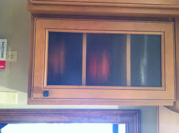 the benefits and challenges of glass front cabinets