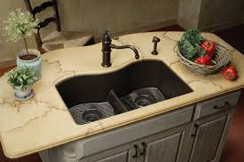 kitchen small iron sink with curvy faucet complete with its