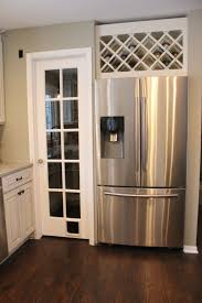 wine rack cabinet over refrigerator good way to utilize the space above the fridge wine rack for the