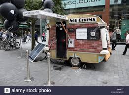 tiny small caravan cinema smallest sol art fun stock photo