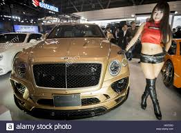 bentley custom tokyo japan 13th jan 2017 a model poses next to a bentley
