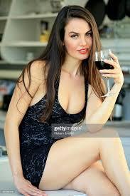 Beautiful Sexy   beautiful sexy woman drinking a glass of red wine stock photo