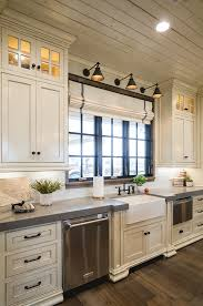 Light Above Kitchen Sink Off White Kitchen With Grey Expo Quartz Countertop Kitchen