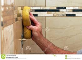 Grout Tile Hand Applying Grout To Wall Tiles Royalty Free Stock Photography