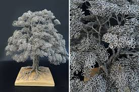 artist makes intricate tree sculptures by twisting single strands