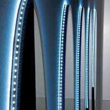led lighting strips running around the outer rim of these bathroom