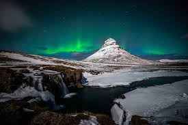 iceland in january northern lights iceland kirkjufell mountain volcano rock waterfall snow night