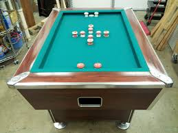 amazing wooden pool dining table with gren rug also cabinet