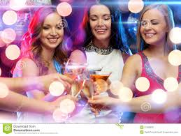 three smiling women with cocktails in club stock photo image