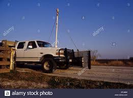 hunting truck hunters in their truck cross through a bump gate while quail