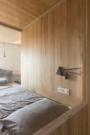 small studio organized around a wooden box volume