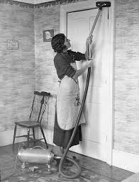 1930 - woman with vacuum in