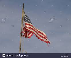 Ripped American Flag An Old Ripped American Flag Against The Sky Stock Photo Royalty