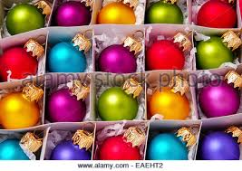 up of box of colorful glass baubles and lighted
