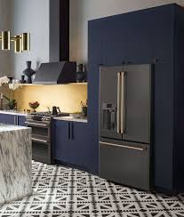 what color appliances with blue cabinets black brass navy kitchen color palette sponsored modern