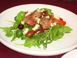 pan roasted sirloin with salad of arugula sweet peppers and