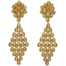 cleef and arpels gold dangle earrings at 1stdibs