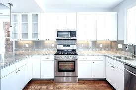 black backsplash in kitchen backsplash with white cabinets and black countertops davidarner com