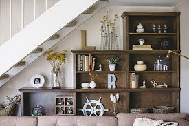 Living Room With Stairs Design 12 Storage Ideas For Under Stairs U2013 Design Sponge