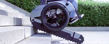 Power Chair With Tracks Watch This Self Balancing Wheelchair Can Climb And Descend Stairs