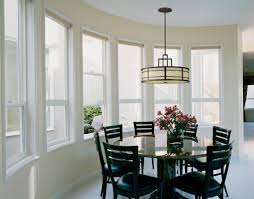 fresh black dome pendant lights hung above the dining table