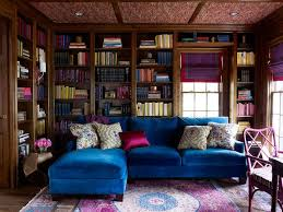 sapphire blue velvet sectional with pink and gray rug