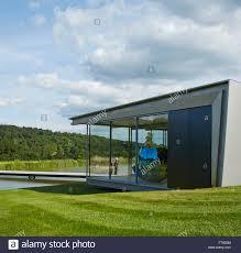 glass pavilion elevation of lake with footbridge glass pavilion and jeff koons