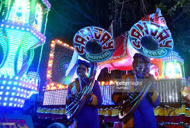 wedding band play members of an indian wedding band play brass instruments during a