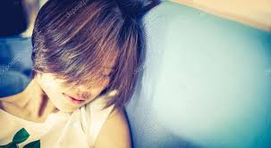 sleeping on short hair short hair japanese teenager sleeping on sofa with copy space