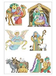 capture the spirit in these 6 cross stitched ornaments