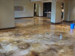 floor white pillars design with acid concrete stain and fireplace
