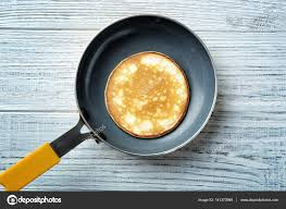 cuisine preparation preparation of pancakes on pan top view stock photo belchonock