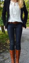 skinny jeans knee high brown boots blazer and white top layered