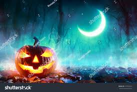 halloween pumpkin head jack lantern with burning candles over black background fiery pumpkin haunted forest moonlight stock photo 479765812