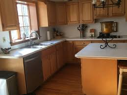 what paint works best on kitchen cabinets painting my 80s style kitchen cabinets
