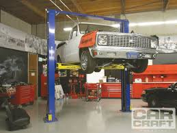 G Force Garage Flooring by Choosing The Proper Garage Car Lift Two Post Lifts Rod Network